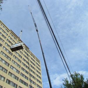 Crane lifting HVAC