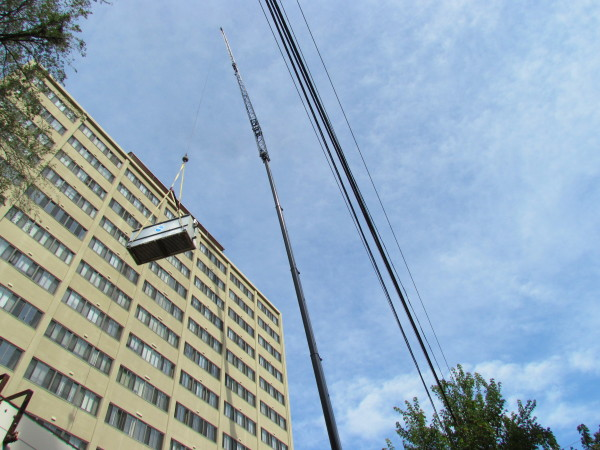 Crane lifting HVAC